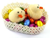 An isolated basket with Easter eggs and ducklings Royalty Free Stock Image