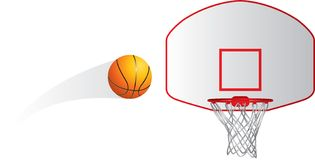 Isolated basketball and hoop. Isolated basketball flying towards the hoop Stock Image