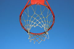 Isolated basketball net on blue sky background. Isolated worn basketball net on blue sky background Stock Photo