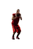Isolated basketball player in action is flying Stock Photo