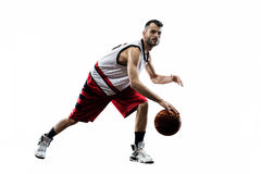Isolated basketball player in action is flying Royalty Free Stock Images