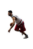 Isolated basketball player in action is flying Stock Photos