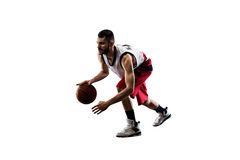 Isolated basketball player in action is flying Royalty Free Stock Photos