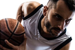 Isolated basketball player in action is flying Royalty Free Stock Photography