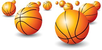 Isolated basketballs. Scattered basketballs on an isolated white background Royalty Free Stock Images