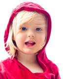Isolated beach portrait of a cute child in red. Close-up portrait of a cute young boy in red at the beach isolated on white Stock Photography