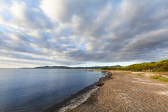 Isolated beach at sunrise with clouds, Sardinia, Italy. Isolated beach at sunrise with clouds, Sardinia Stock Photography