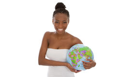 Isolated beautiful african american woman with globe in her hand Royalty Free Stock Image