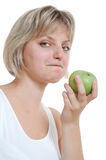 Isolated beautiful blond girl with an apple Stock Images