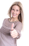 Isolated beautiful blond young woman with thumbs up Royalty Free Stock Image