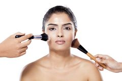 Beautiful indian woman with make up brush Royalty Free Stock Photo