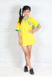 Isolated Beautiful woman with smiling wearing Brazil football to. Beautiful woman with smiling wearing Brazil football top overwhite background Royalty Free Stock Photos