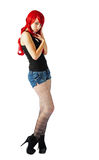 A isolated Beautiful woman wearing a red wig Royalty Free Stock Photo