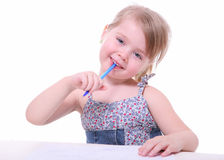 Isolated beautiful young girl thinking looking. Isolated beautiful young girl with a pen looking, thinking and imagining Stock Photography