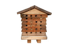 Isolated Bee House made of wood. Solitary bee apiary house made of wood. Isolated bee house with round holes for entrances Royalty Free Stock Images