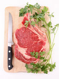 Isolated beef rib and parsley Stock Photos