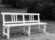 Isolated bench  in the park.Calm place for thinking. Stock Images