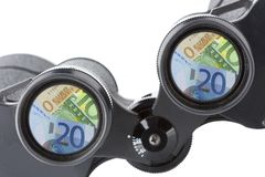 Isolated binoculars with money Royalty Free Stock Image