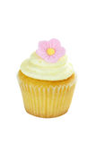 Isolated Birthday Cupcake with Flower. Isolated birthday cupcake with sing;e pink flower. Clipping path included Stock Photo