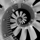 Isolated on black abstract spiral fractal made of truck diesel engine fan silver air screw. Spiral background pattern engine fan. Truck engine fan abstract Stock Photo
