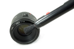 Isolated Black Camera DSLR lens and lens pen Royalty Free Stock Photo