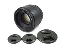 Isolated Black Camera Lens and lens Cap Stock Photography