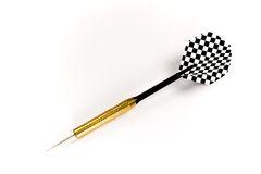 Isolated black dart. A dart with black shaft and black and white checkered feathers isolated against a white background Royalty Free Stock Images