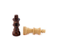 Pawn black and defeat white kings Isolated on back Royalty Free Stock Image