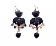 Isolated black earrings. Pair of black earring isolated on white Stock Photography