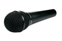 Isolated black microphone. A closeup of a black microphone isolated against a white background Stock Photo
