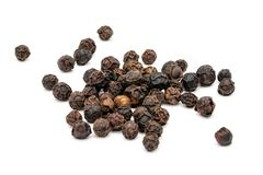 Isolated black peppercorns royalty free stock photo