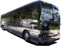 Isolated Black Tour Charter Bus. Parked black tour / charter bus with dappled sunlight. Isolated stock photography