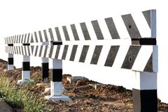 Isolated black-and-white fence that blocks the way. Isolate close-up, wooden fence, white and black patterns that block the way on concrete pillars mounted on royalty free stock image