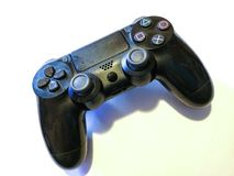 Black wireless controller. Isolated black wireless gaming controller with a white background royalty free stock image