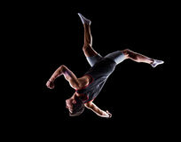 Isolated black young man is jumping on trampoline Stock Photos