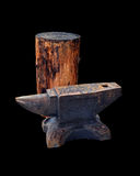 Isolated blacksmith anvil and wooden deck Royalty Free Stock Photo