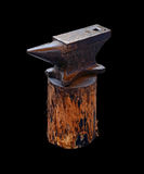 Isolated blacksmith anvil on wooden deck Stock Image