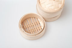 Isolated blank round steamer bamboo basket or crate Royalty Free Stock Photo