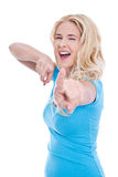 Isolated blond attractive woman pointing Royalty Free Stock Image