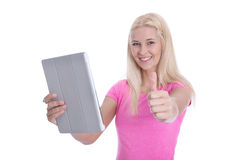 Isolated blond female student with digital tablet and thumb up. Royalty Free Stock Photography