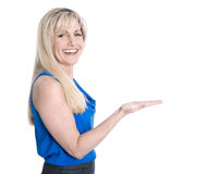 Isolated blond mature woman is presenting with hand over white. Stock Photos