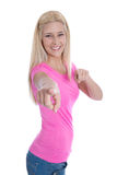 Isolated blond young woman in pink pointing with her finger. Royalty Free Stock Photography