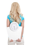 Isolated blonde girl with scales Royalty Free Stock Photos