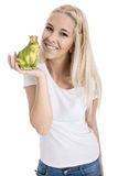 Isolated blonde teenager with frog in her hand - concept for lov Stock Images