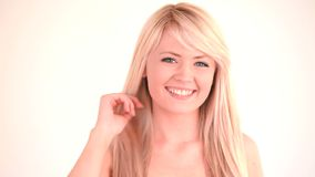 Isolated blondhaired woman posing and blowing a kiss stock video