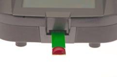 Isolated blood sugar meter. Blood drop on testing strip of diabetes blood sugar meter stock photo