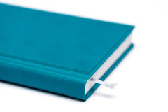 Isolated blue notebook Stock Photography