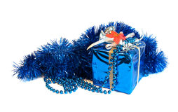 Isolated blue present with fir and beads. Xmas blue decorative wrapped present and beads on white background Stock Photography