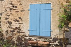 Isolated blue shutters of a window in the countryside Germany, Europe. Isolated blue shutters of a window in the countryside Moselkern, Germany, Europe stock photo