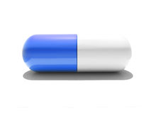 An isolated blue and white capsule Royalty Free Stock Image